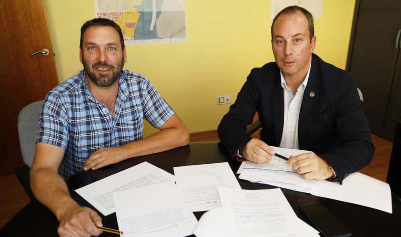 Miguel Ángel Sánchez, delegado del Citopic en León, y Óscar Sánchez, decano del colegio. MARICANO PÉREZ